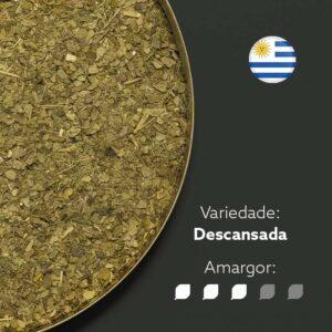 Erva-mate Canarias Edição especial em recipiente metálico ocupando metade esquerda da imagem. Fundo cinza escuro. Bandeira circular do Uruguai no canto superior direito. Em escrito: Variedade - Descansada. Amargor nível 3 de 5.