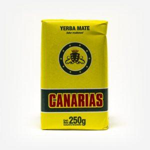 Erva-mate Canárias de 250 gramas em fundo branco. Pacote amarelo com logo escrita em vermelho. Faixa verde ao fundo da logo. Em escrito: Yerba Mate, Canárias.